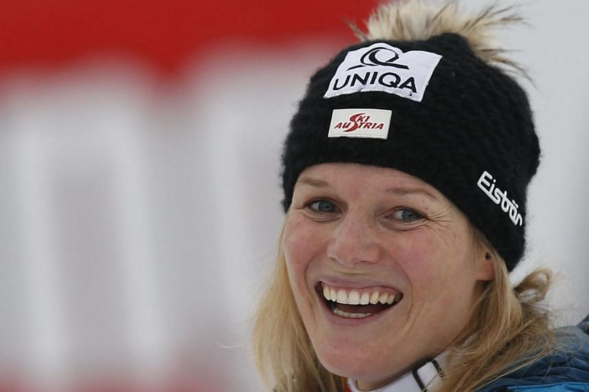 Austria's Marlies Schild reacts after winning the women's giant slalom World Cup race in the Tyrolean ski resort of Lienz, on Dec 29, 2013.Two Austrian competitors have received kidnap threats on the eve of the Winter Olympics in Sochi, heighte
