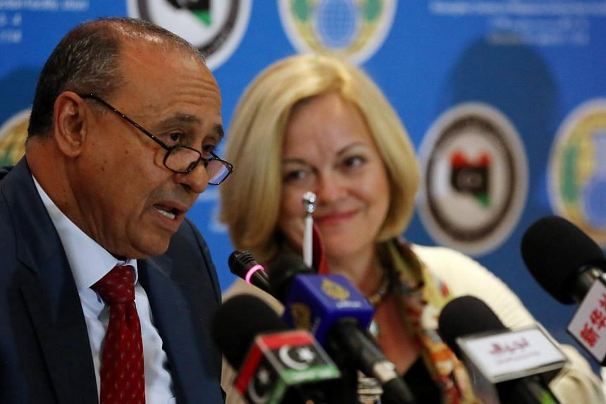 Libyan Foreign Affairs Minister Mohamed Abdulaziz (left) speaks, as US Ambassador to Libya Deborah Jones (right) looks on, during a press conference in Tripoli on Feb 4, 2014.Libya has completely destroyed the chemical arsenal it inherited from