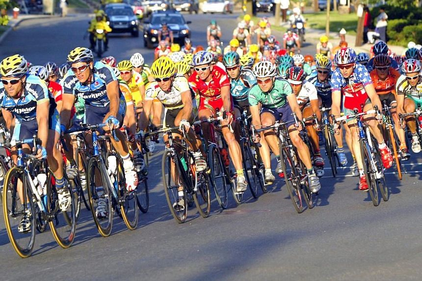 Women rate top male endurance cyclists more attractive than lower-ranked ones even without knowing who they are, a finding that sheds light on the mating game, a scientist said on Feb 5, 2014. -- FILE PHOTO: STARHUB