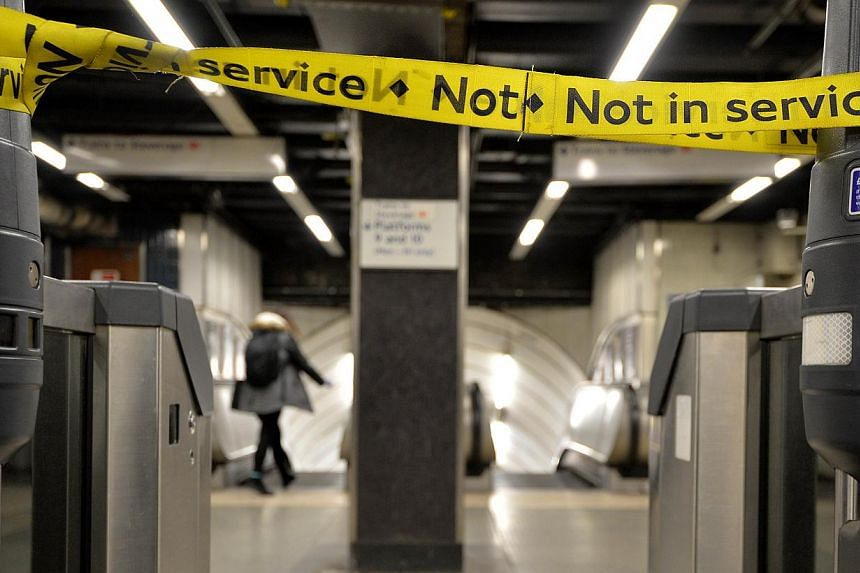 A barrier reading 'Not in Service' is seen at Mooregate underground station in London on Feb 4, 2014.Workers on London's Underground train system kicked off a 48-hour strike at 9:00 pm (1:00pm Singapore time) on Tuesday, threatening chaos for c