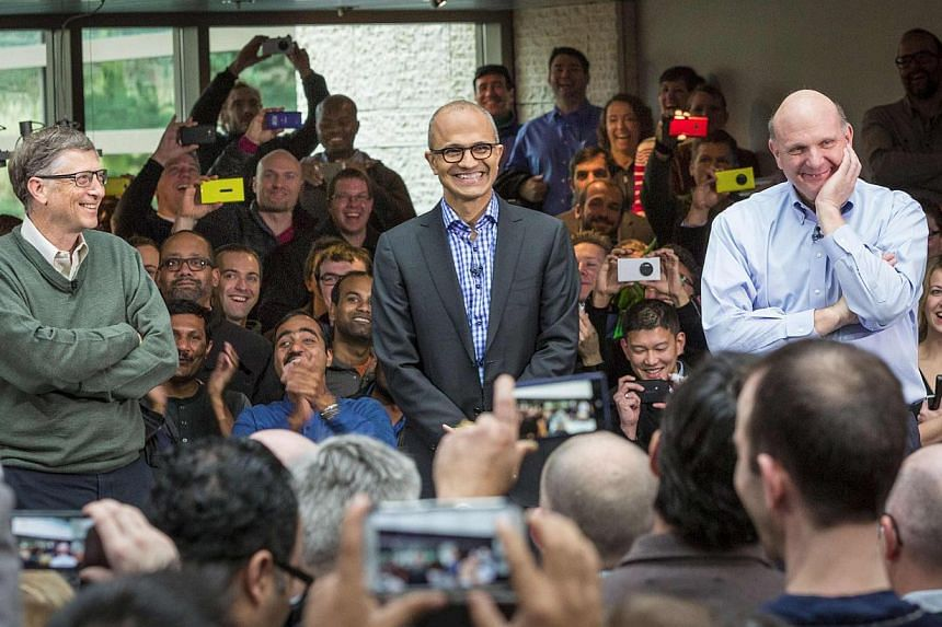 Mr Satya Nadella (centre), Microsoft's new CEO, addresses employees along with founder and technology advisor Bill Gates (left) and outgoing CEO Steve Ballmer (right) on the company's campus in Redmond, Washington, on Tuesday, Feb 4, 2014. India on W
