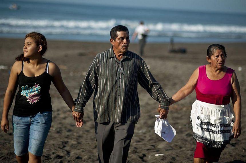 (From left) Fatima Mabea Alvarenga, Jose Ricardo Orellana and Maria Julia Alvarenga in Garita Palmera, 102km west of San Salvador on Feb 4, 2014. The family ofMr Jose Salvador Alvarenga is eagerly anticipating a reunion with the Pacific castawa
