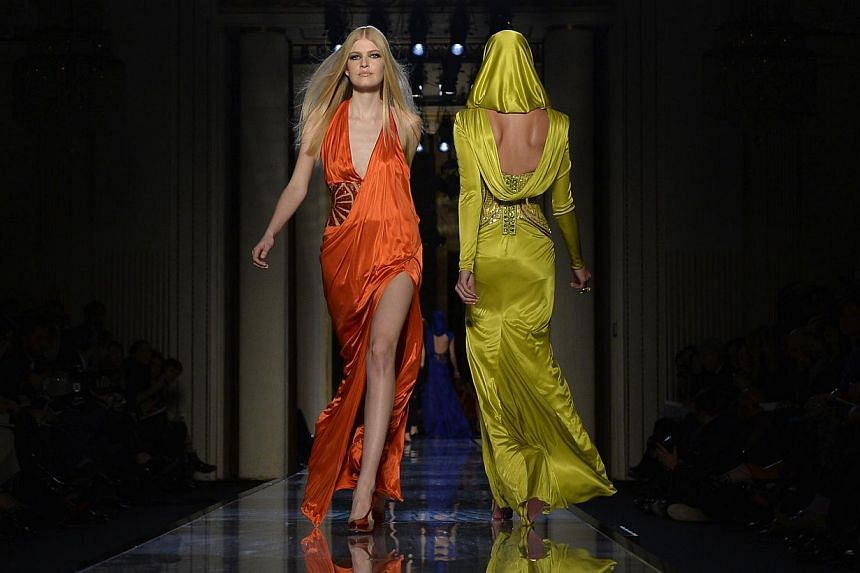 A model presents a creation by Italian designer Donatella Versace during the 2014 Haute Couture Spring-Summer Versace collection show on Jan 19, 2014 in Paris. Versace is expected to choose between three potential partners vying for a minority stake