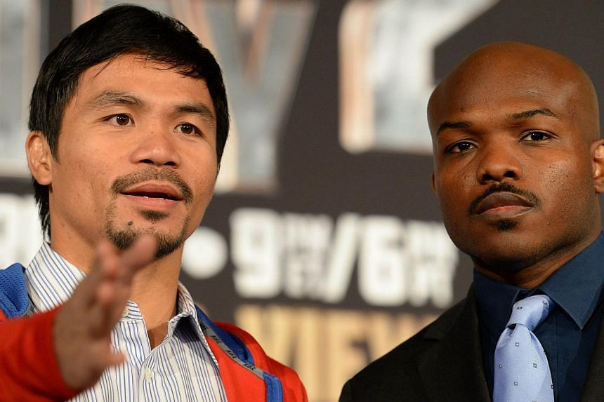 Filipino boxer Manny Pacquiao (left) and Timothy Bradley of the US attend a press conference announcing their rematch for the World Boxing Organisation welterweight championship in Beverly Hills Hotel in Beverly Hills, California, on Feb 4, 2014.&nbs