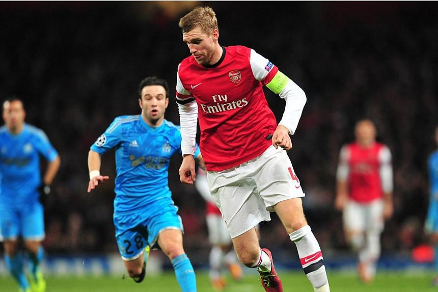 Arsenal defender Per Mertesacker (centre) during a Champions League match against Marseille at the Emirates Stadium on Nov 26, 2013.Arsenal have not lost an English Premier League match where Mertesacker and Laurent Koscielny have completed the
