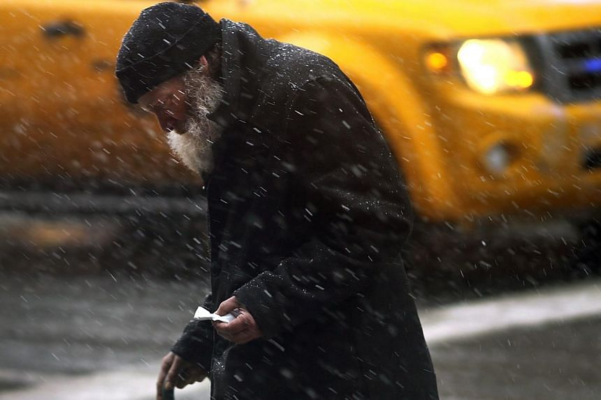 A man walks across a street during a snow storm in Manhattan on Feb 3, 2014, in New York City. -- FILE PHOTO: AFP