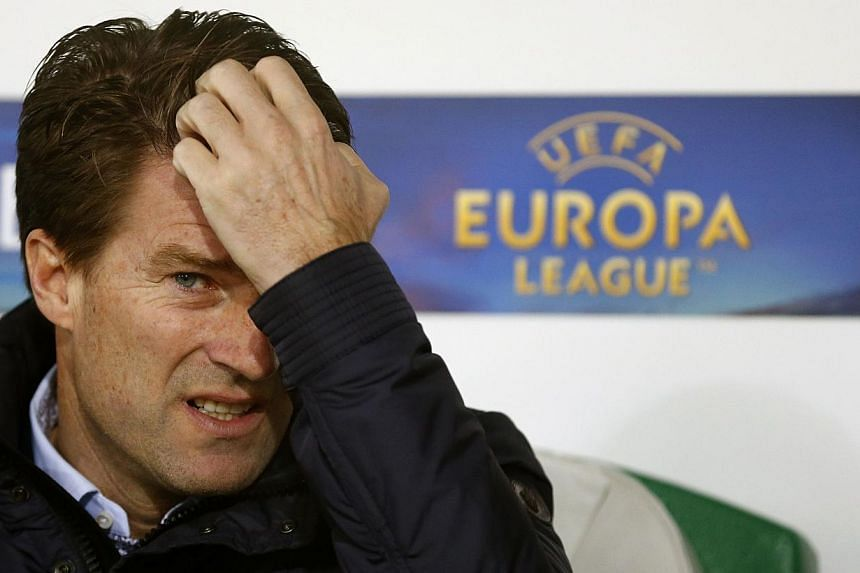 Swansea City's manager Michael Laudrup gestures before a Europa League match against St Gallen on Dec 12, 2013.Laudrup became the latest manager to fall victim to a jinx that has now claimed five of the last six men who led their clubs to victo