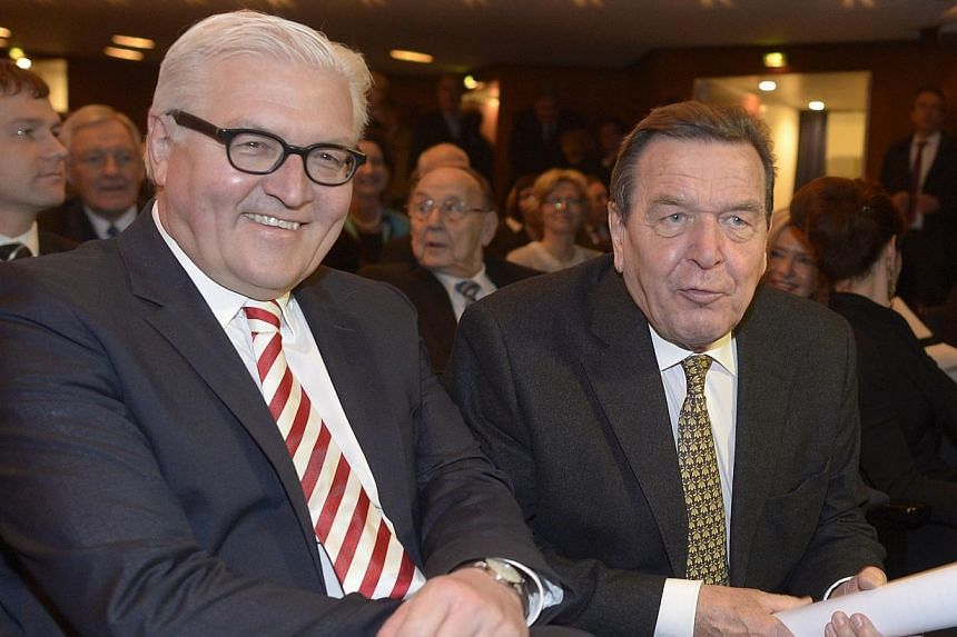 Former German Chancellor Gerhard Schroeder (right) and German Foreign Minster Frank-Walter Steinmeier attend a birthday party, on Jan 19, 2014. The US National Security Agency (NSA) bugged the phone of former German Chancellor Gerhard Schroeder from