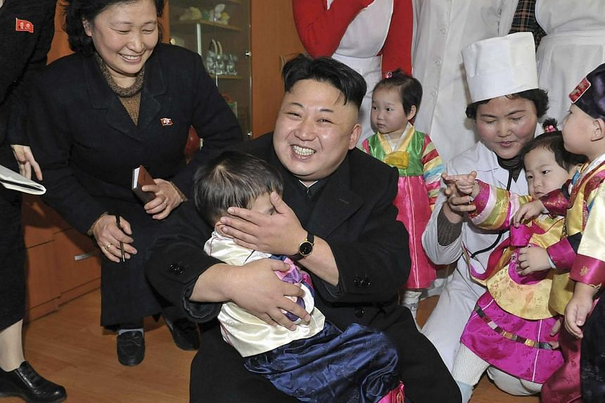North Korean leader Kim Jong Un visits an orphanage in this undated photo released by North Korea's Korean Central News Agency (KCNA) in Pyongyang on Tuesday, Feb 4, 2014. See more pictures from around the world in Through The Lens' Today in Pictures