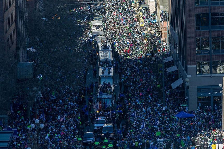 Members of the Seattle Seahawks take part in the Seahawks' Super Bowl XLVIII Victory Parade in Seattle, Washington, on Feb 5, 2014. -- PHOTO: AFP