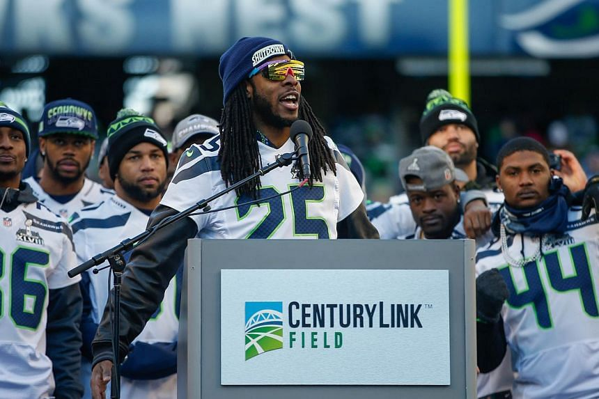 Cornerback Richard Sherman of the Seattle Seahawks speaks to the crowd during ceremonies following the Seahawks' Super Bowl XLVIII Victory Parade at CenturyLink Field, in Seattle, Washington, on Feb 5, 2014. -- PHOTO: AFP