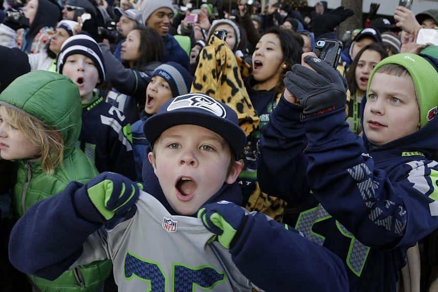 Young Seattle Seahawks fans cheer during the NFL team's Super Bowl victory parade in Seattle, Washington, on Feb 5, 2014. -- PHOTO: REUTERS