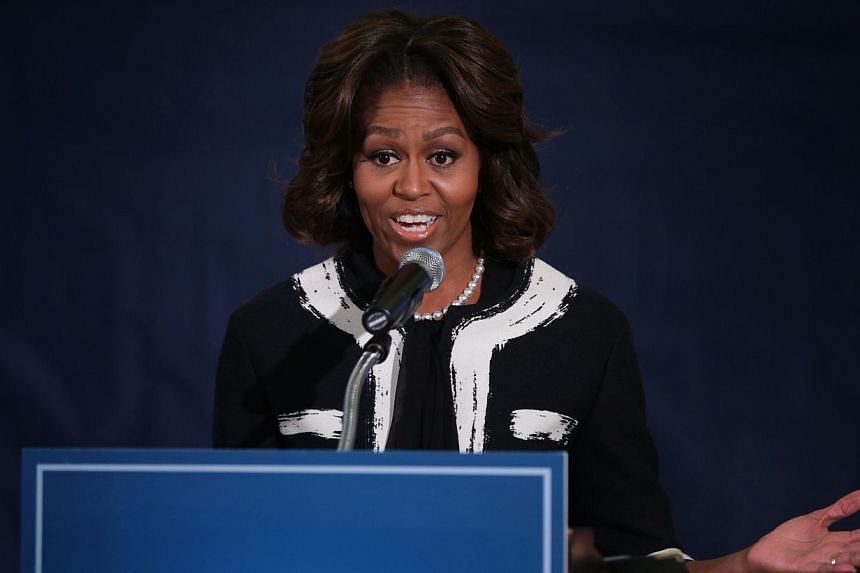 US first lady Michelle Obama delivers remarks at a FAFSA (Free Application for Federal Student Aid) workshop at the TC Williams High School on Feb 5, 2014 in Alexandria, Virginia. The Obama administration enlisted the help of First Lady Michelle Obam