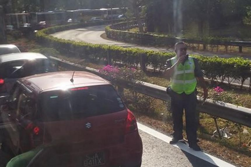 Traffic came to a standstill on the BKE in the direction of the Pan Island Expressway (PIE) at the Bukit Panjang Road entrance during the morning rush hour on Thursday.-- PHOTO:IWIN NUX