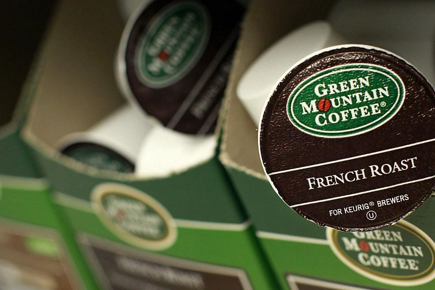 Green Mountain Coffee single-serve K-Cups are pictured in New York, in this file photo from May 3, 2012. Green Mountain Coffee Roasters Inc, maker of the popular Keurig single-cup coffee brewer, said on Wednesday that the Coca-Cola Co bought a 10 per