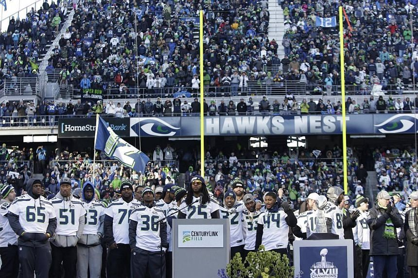 Seattle Seahawks players and fans attend a rally at Century Link Field after the NFL team's Super Bowl victory parade in Seattle, Washington on Feb5, 2014. An estimated 700,000 Seattle Seahawks fans braved sub-freezing temperatures to celebrate