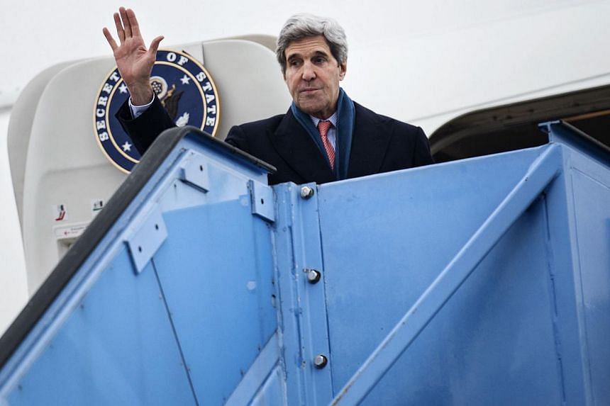 U.S. Secretary of State John Kerry waves while boarding his plane at Franz-Josef-Strauss Airport in Munich, southern Germany, on Feb 2, 2014. Amid a bitter spat between the United States (US) and Israel, Secretary of State John Kerry said on Wed