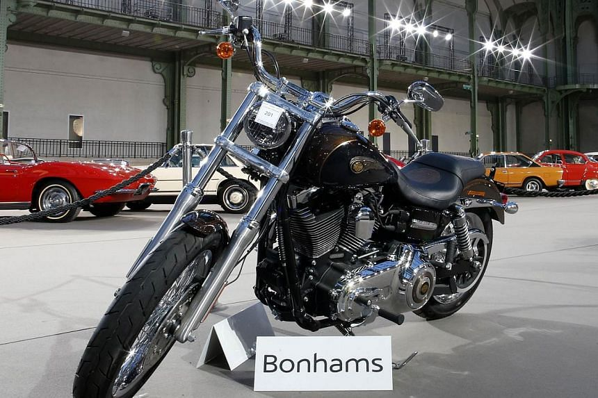 The 1,585 cc Harley Davidson Dyna Super Glide, donated to Pope Francis last year and signed by him on its tank, is displayed as part of Bonham's Les Grandes Marques du Monde vintage and classic cars sale at the Grand Palais in Paris, on Feb 5, 2014.