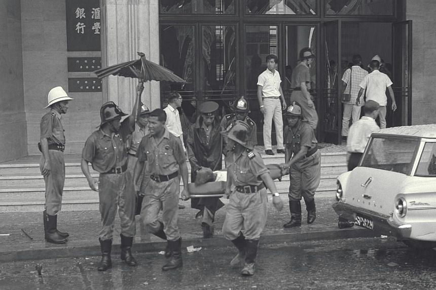 The MacDonald House bombing was the worst of a string of attacks by Indonesian saboteurs during Konfrontasi, the Indonesia-Malaysia Confrontation that happened from 1963 to 1966.-- ST FILE PHOTO:KOK AH CHONG