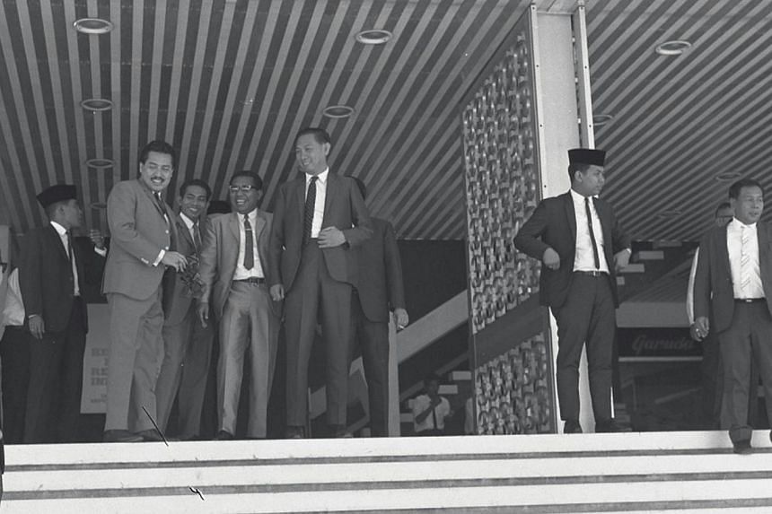 Indonesian Embassy officials leaving WismaHouse to receive the bodies of the two executedIndonesian saboteurs at the Changi Jail.-- ST FILE PHOTO:KOK AH CHONG