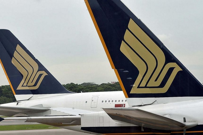 Profits at Singapore Airlines in the three months to the end of December fell by 65 per cent to $50 million, mainly due to non-operating expenses.-- FILE PHOTO: AFP