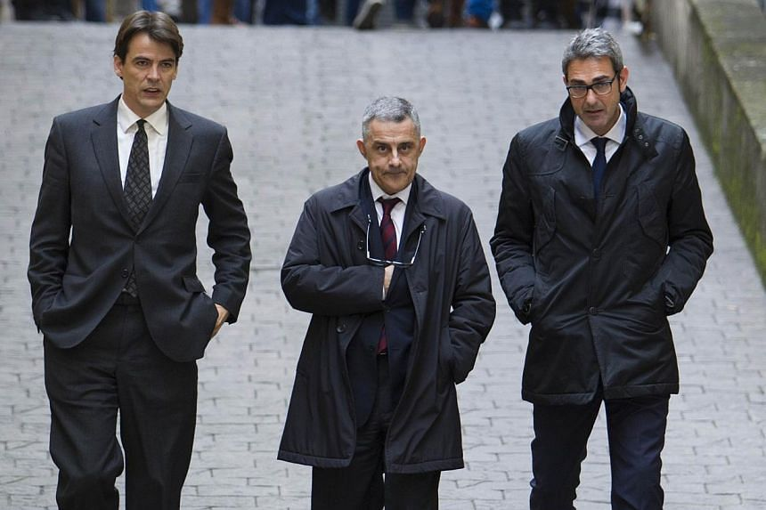 Spanish Princess Cristina's lawyers Jesus Silva (center) and Jaume Riutord (left) arrive at a court in Palma de Mallorca, on the Spanish Balearic Island of Mallorca, to hear witnesses in the Noos corruption case on Jan 25, 2014. A judge will quiz Spa