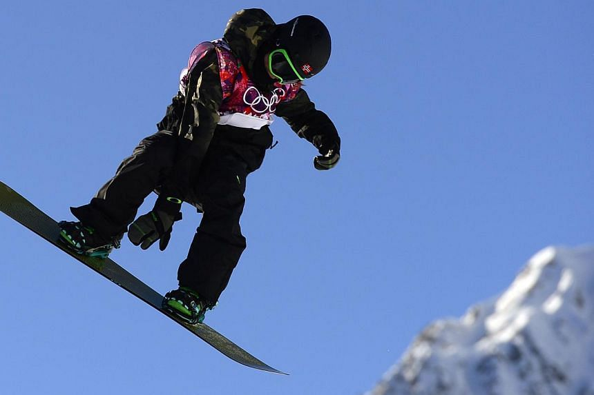 Norway's Staale Sandbech put in a blazing second run to win the opening heat of the men's snowboard slopestyle qualifiers on Thursday, the first day of competition at the Sochi Olympics. -- PHOTO: AFP