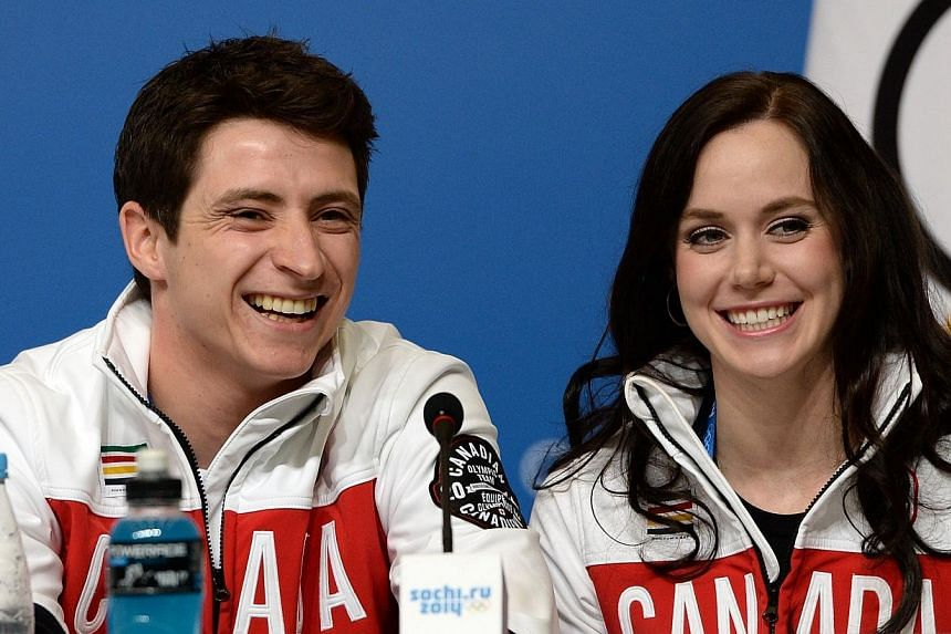 Canadian figure skating dance pair Tessa Virtue (right) and Scott Moir speak at a press conference by Canada's figure skating team in Sochi, on Thursday, Feb 6, 2014. It is not often that Olympians forget who Michael Phelps is. But ice dancer Mo