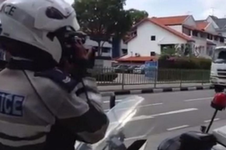 Traffic Police conducting enforcement in three school zones in the eastern part of Singapore on Feb 6, 2014. -- PHOTO: SCREENGRAB FROM VIDEO