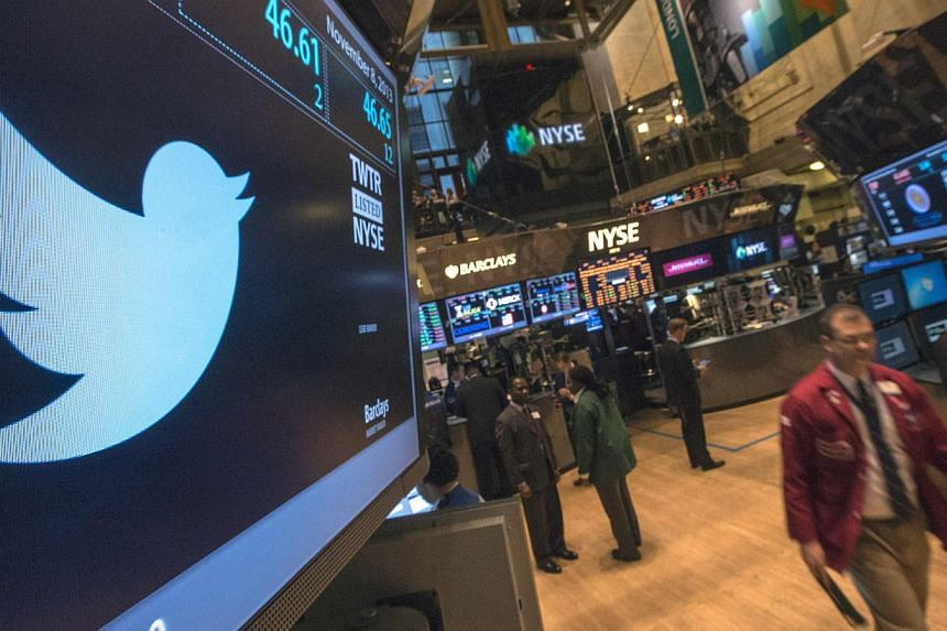 The Twitter logo is displayed on the floor of the New York Stock Exchange in this file photo taken on Nov 8, 2013. Twitter Inc reported anaemic user growth during the final three months of 2013, sending shares sinking after its first quarterly r
