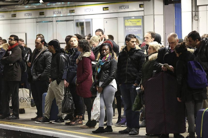 Evening commuters wait on the platform of Victoria tube station in central London, on Feb 5, 2014. Millions of Londoners faced another morning of travel chaos on Thursday as a 48-hour strike by London Underground workers angry at ticket office closur