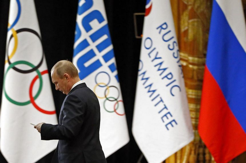 Russian President Vladimir Putin delivers an address before the start of the games. -- PHOTO: REUTERS