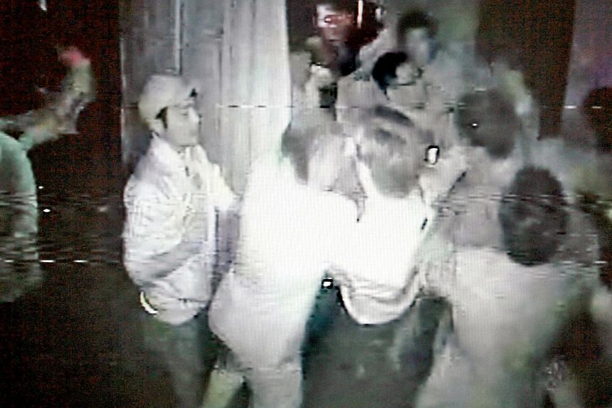 A screenshot from footage of a closed circuit television (CCTV) camera, showing a group of Korean men in a scuffle with security staff from Club Password, a recently opened club in Bras Basah. Three men were charged on Friday with rioting while armed