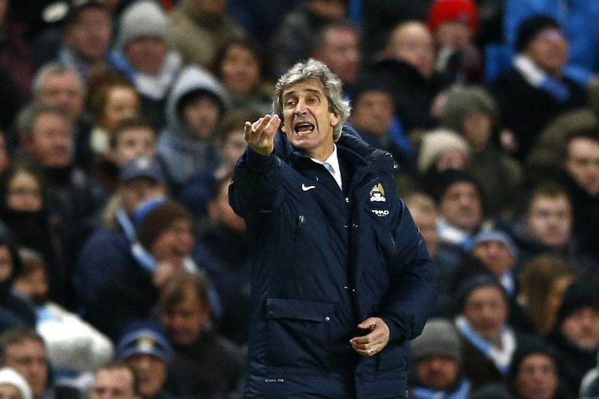 Manchester City's manager Manuel Pellegrini reacts during their English Premier League soccer match against Chelsea at the Etihad Stadium in Manchester, northern England on Feb 3, 2014. Manchester City will look to get their Premier League title chal