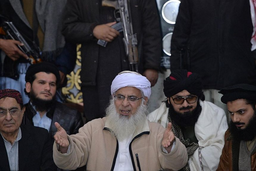 Tehreek-e-Taliban Pakistan (TTP) committee member and chief cleric of Islamabad's Red Mosque Maulana Abdul Aziz (centre) speaks during a press conference in Islamabad on Feb 7, 2014.Pakistan's fledgling peace talks with the Taleban suffered a f