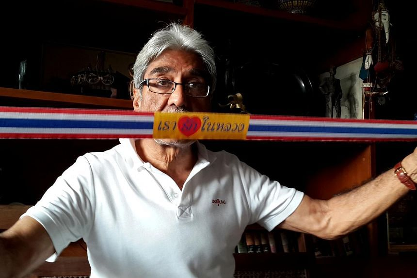 Indian businessman Satish Sehgal with a ''We Love the King'' strap he gives out to people at rallies on the streets. -- ST PHOTO: NIRMAL GHOSH