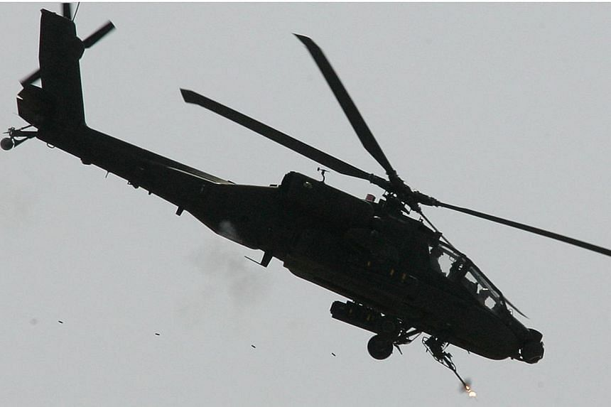 An United States Apache gunship helicopter covering US soldiers during a clearing operation outside Baquba, some 50 km northeast of Baghdad on Oct 8, 2007. The US Defence Department plans to ask Congress for US$4.5 billion (S$5.7 billion) in extra mi