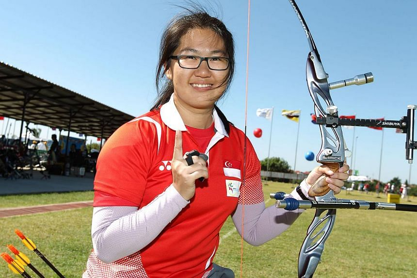 Singapore's gold medallists from the SEA Games, including archer Chan Jing Ru (above), were celebrated at the Multi-Million Dollar Award Programme (MAP) award presentation ceremony held at Swissotel Merchant Court on Friday afternoon.-- ST FILE