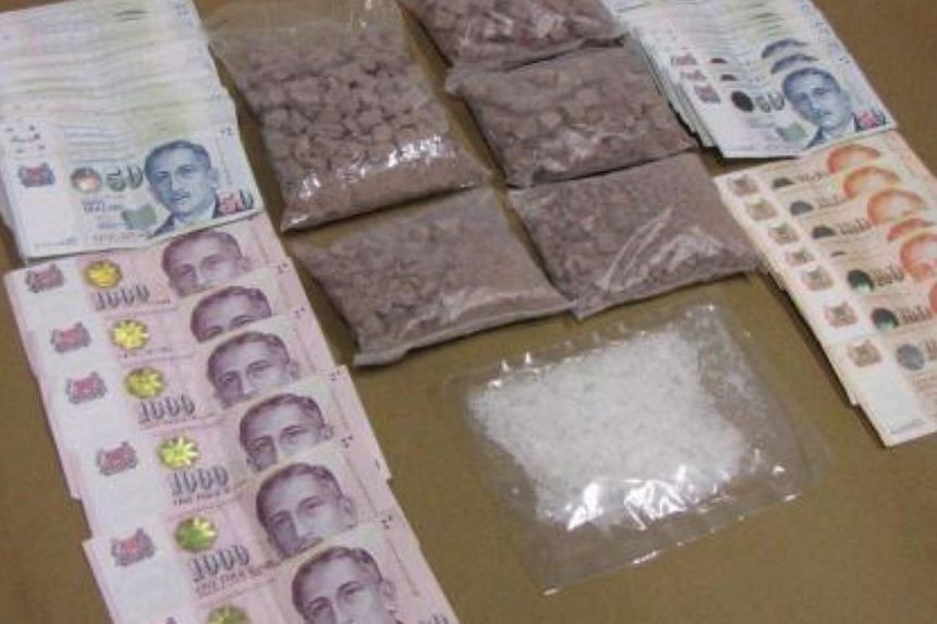 """1.63kg of heroin, 90g of """"Ice"""" andmore than$20,000 incash seized in a Central Narcotics Bureau (CNB) operation on Thursday, Feb 6, 2014. Three men have been arrested over the seizure.-- PHOTO:CENTRAL NARCOTICS BUREAU"""