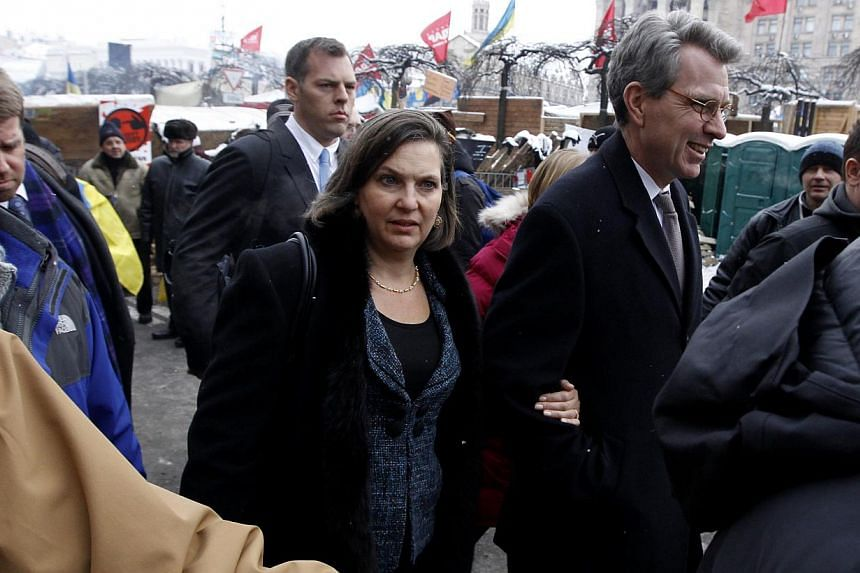 US Assistant Secretary of State for European and Eurasian Affairs Victoria Nuland (centre) and US Ambassador Geoffrey Pyatt walk in the opposition camp at Independence Square in Kiev on Dec 10, 2013.Washington's new top diplomat for Europe, Vic