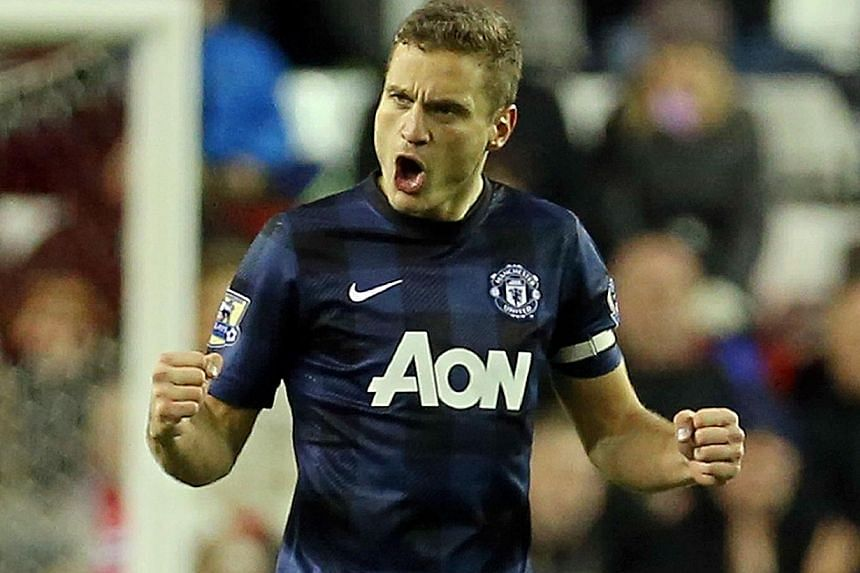 Manchester United's Serbian defender Nemanja Vidic celebrates scoring a goal during a League Cup semi-final first leg match between Sunderland and Manchester United at the Stadium of Light in Sunderland, in north-east England, on Jan 7, 2014. Vidic
