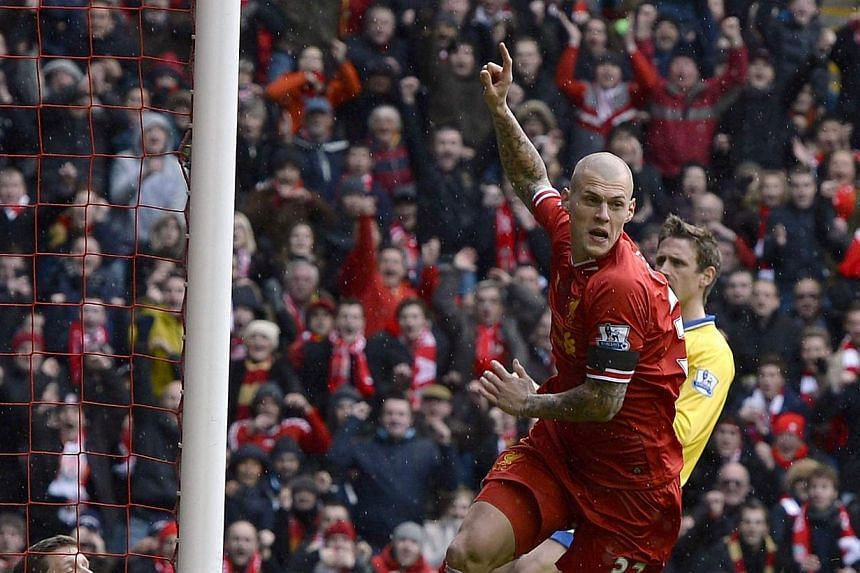 Liverpool's Martin Skrtel celebrates scoring against Arsenal during their English Premier League match at Anfield on Saturday, Feb 8, 2014. -- PHOTO: REUTERS