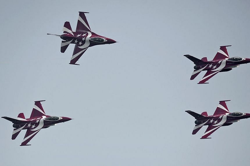 The Republic of Singapore Air Force (RSAF)Black Knights perform an air display during the RSAF's45th anniversary Family Day celebrationson Saturday, Feb 8, 2014. -- ST PHOTO:MUGILAN RAJASEGERAN