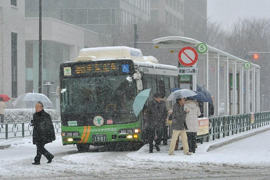Passengers get off from a bus at JR Tokyo Station on Feb 8, 2014.-- PHOTO: AFP