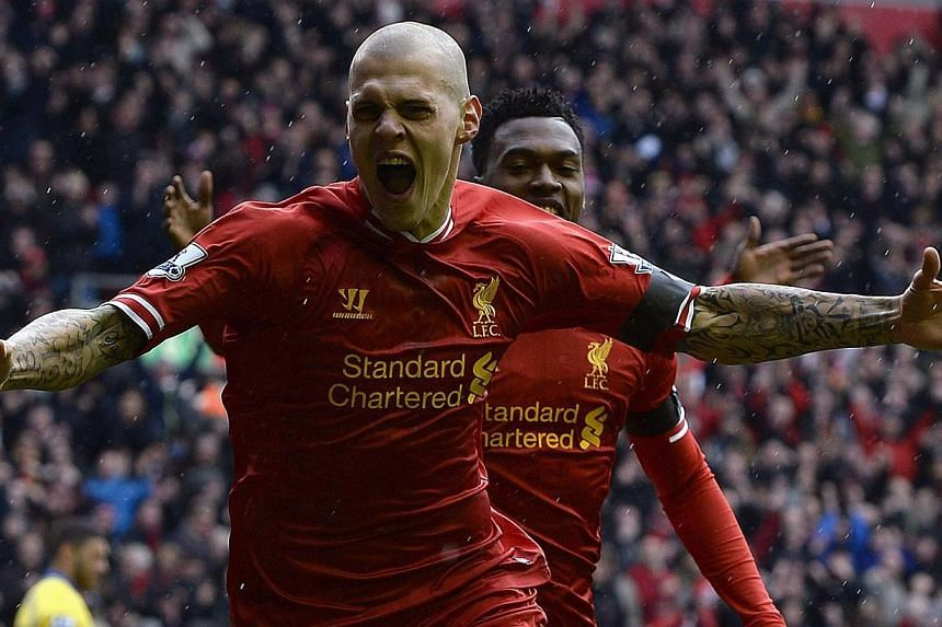 Liverpool's Martin Skrtel (centre) celebrates scoring against Arsenal during their English Premier League match at Anfield on Saturday, Feb 8, 2014. -- PHOTO: REUTERS