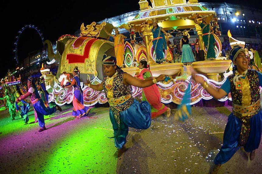 Colours explode at the biggest Chingay parade since the annual Chinese New Year procession was first held in 1973. The parade will weave through the F1 Pit Building again tonight. -- ST PHOTO: DESMOND WEE