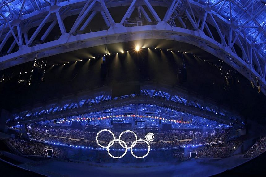 One of the Olympic Rings fails to completely illuminate during the opening ceremony of the 2014 Sochi Winter Olympics. --PHOTO: REUTERS