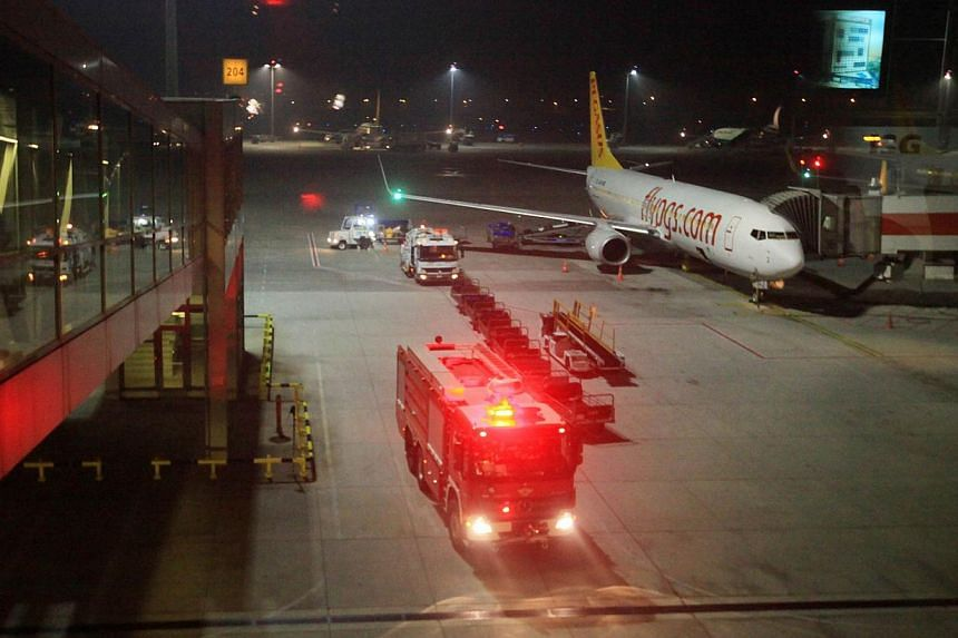 A fire truck is seen at Sabiha Gokcen Airport on February 7, 2014 in Istanbul. Turkey scrambled a jet fighter today to force down an airliner from Ukraine after a would-be hijacker on board ordered it to Sochi where the Winter Olympic opening ceremon