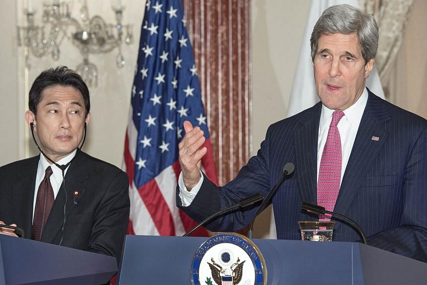 US Secretary of State John Kerry (right) and Japanese Foreign Minister Fumio Kishida deliver remarks to the media after their private bilateral meeting on Feburary 7, 2014, at the US Department of State in Washington, DC. --PHOTO: AFP