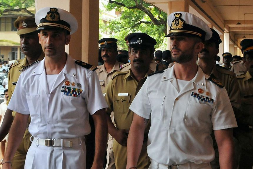 Italian marines Latore Massimiliano (left) and Salvatore Girone (right) are escorted by Indian police outside a court in Kollam, India in May, 2012. --PHOTO: AFP